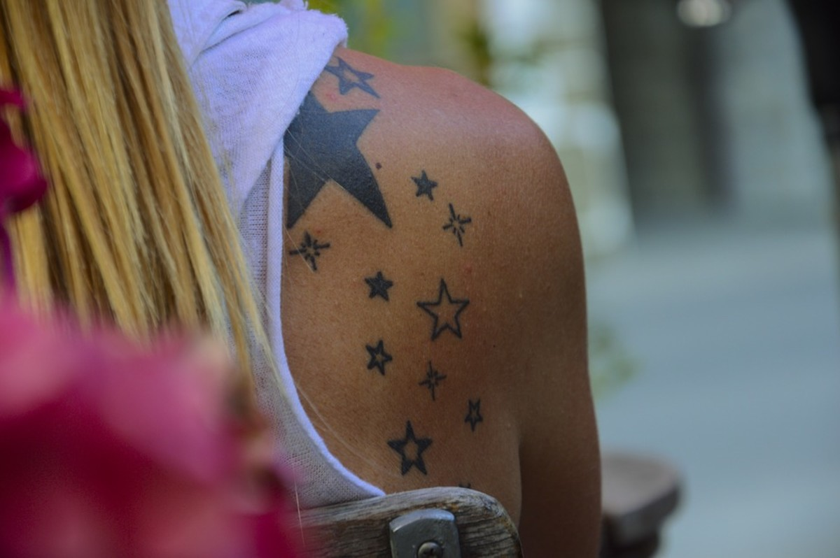 A tattoo of stars on the shoulder.