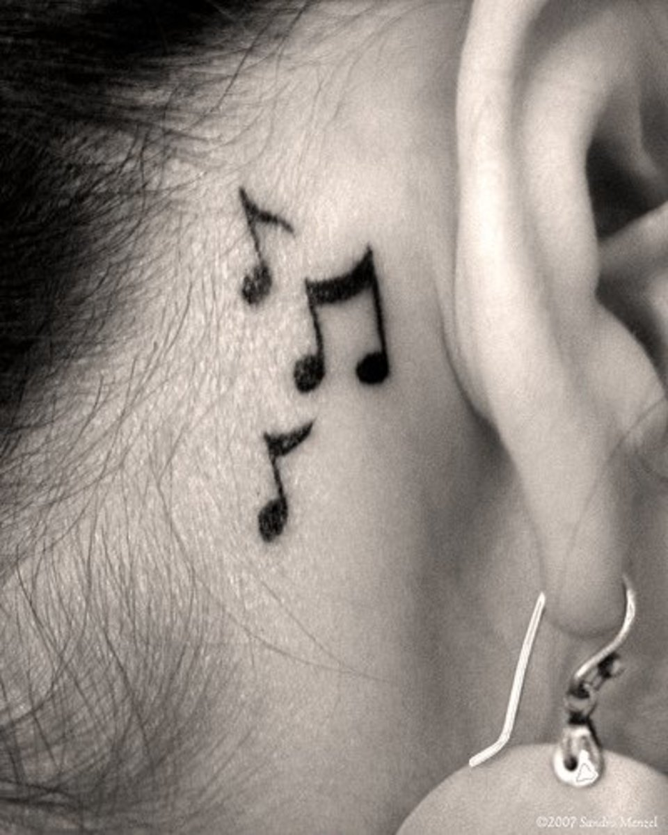 A tattoo of musical notes behind the wearer's ear.