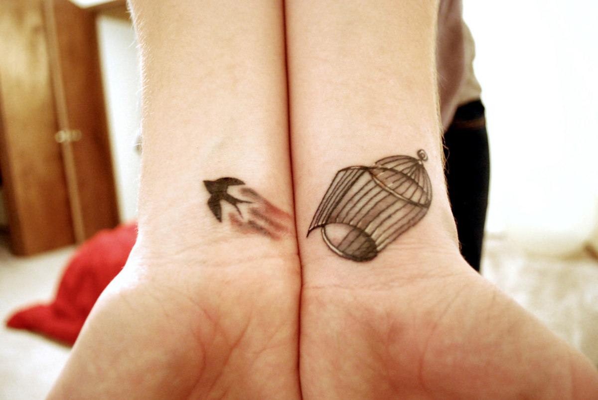 Bird and cage tattoos.