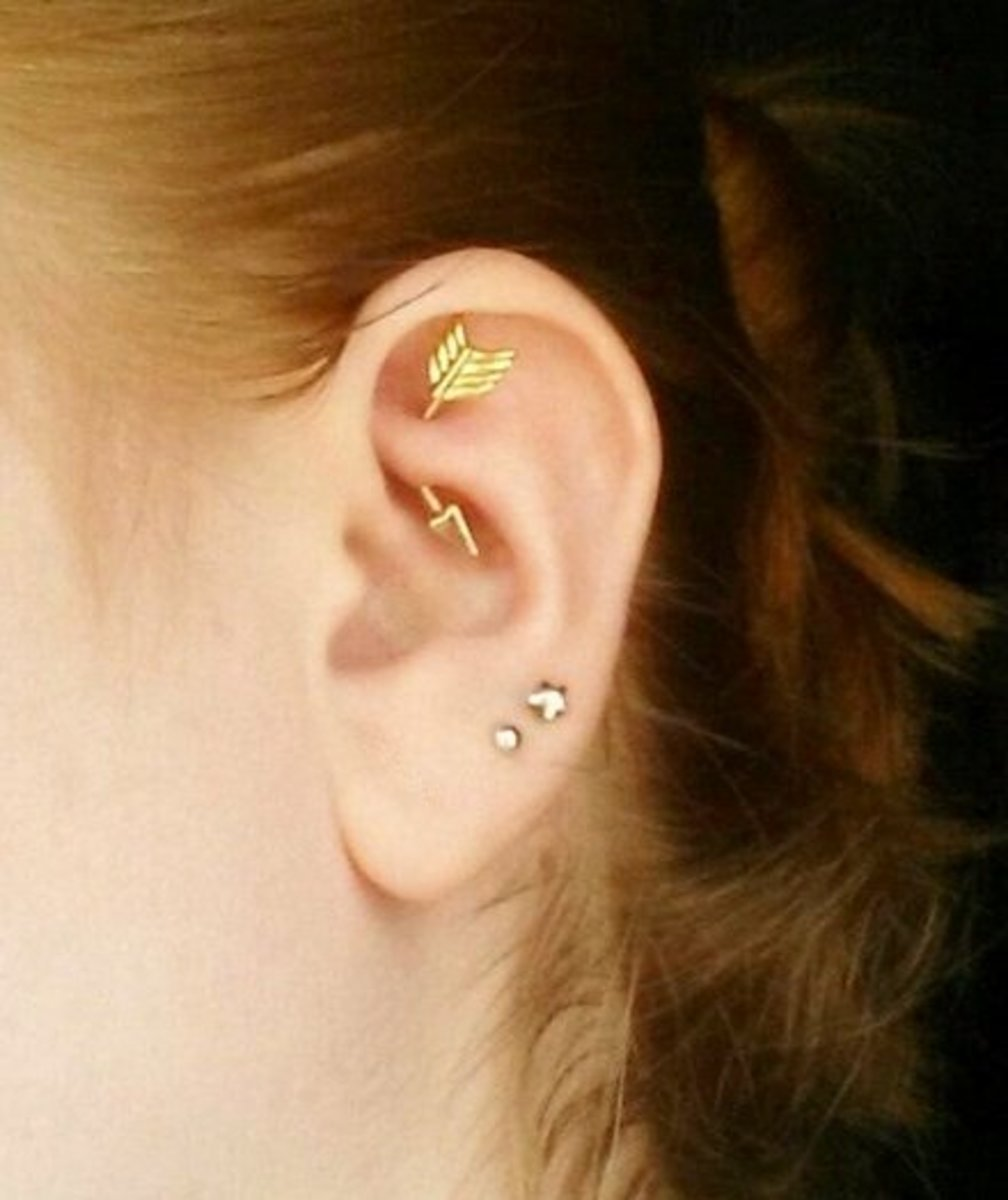 This woman has three ear piercings; two in her lobe, and a rook piercing.