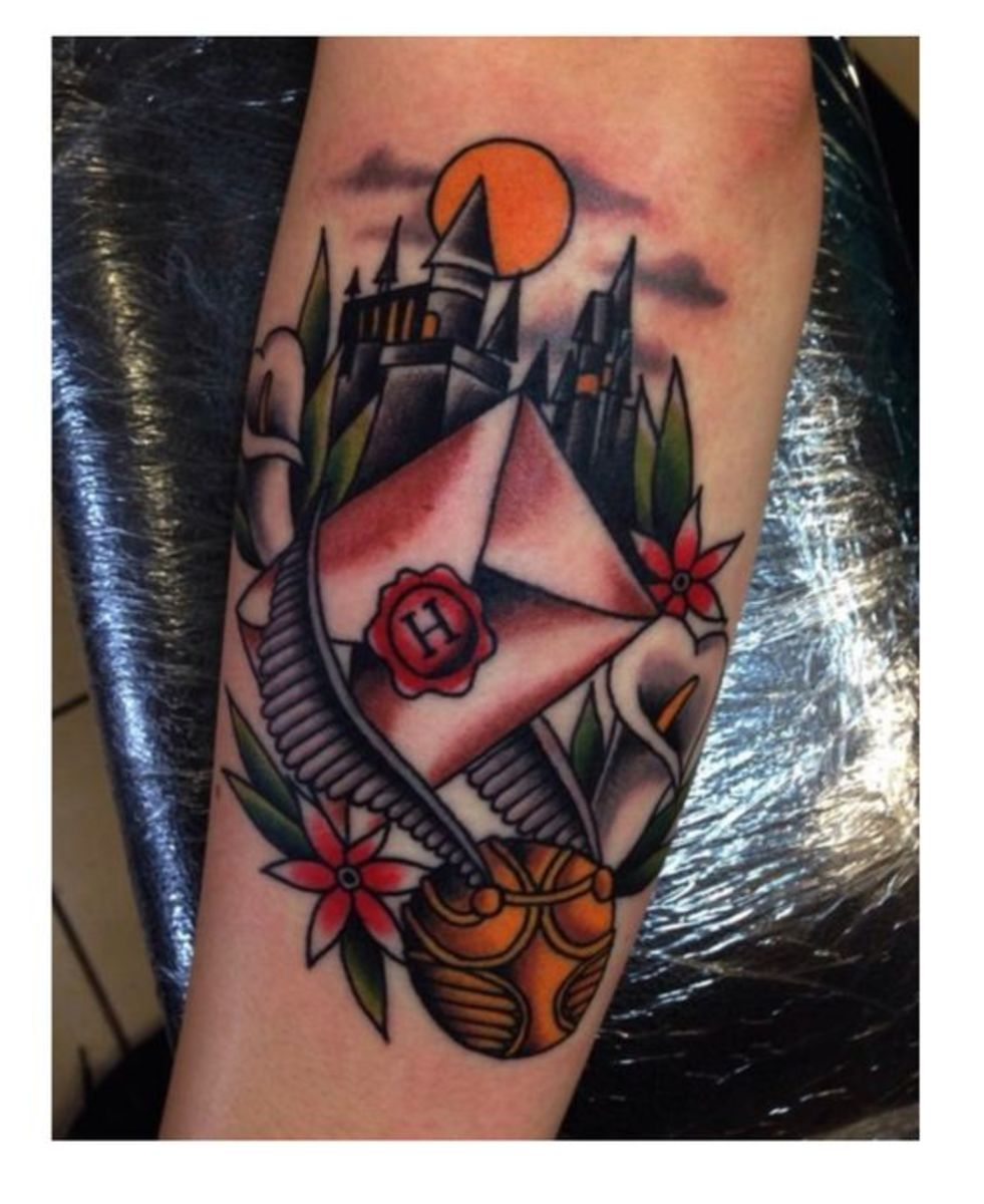Castle and letter tattoo