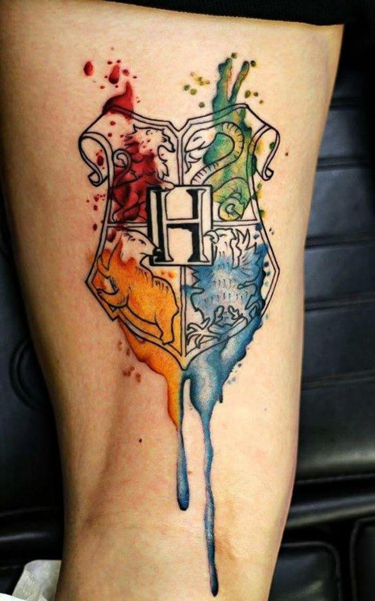 Hogwarts crest watercolour tattoo