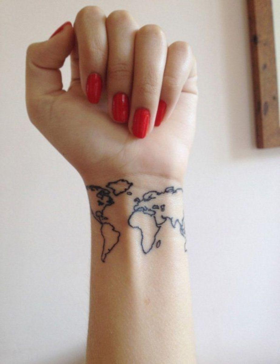 A full panorama tattoo that wraps around the wrist.