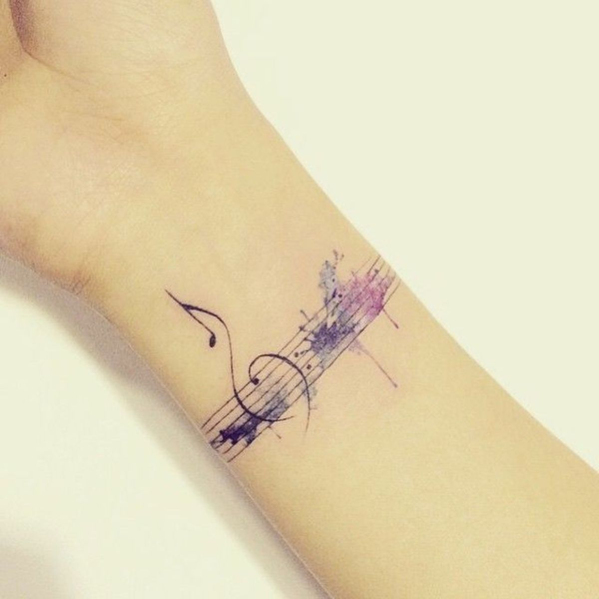 A line of music makes a lovely tattoo bracelet—especially with watercolor.