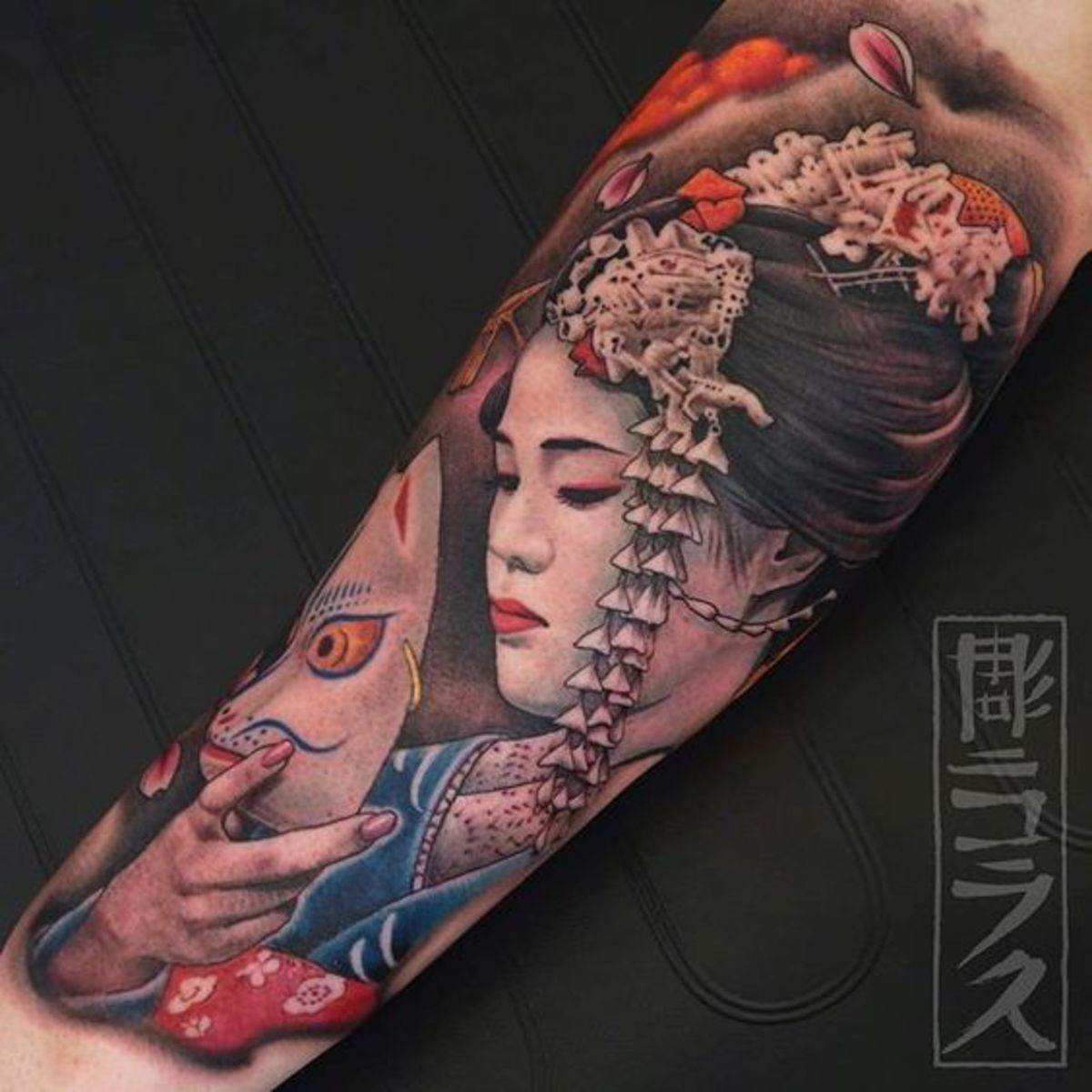 Geisha (or maiko) with kitsune mask.