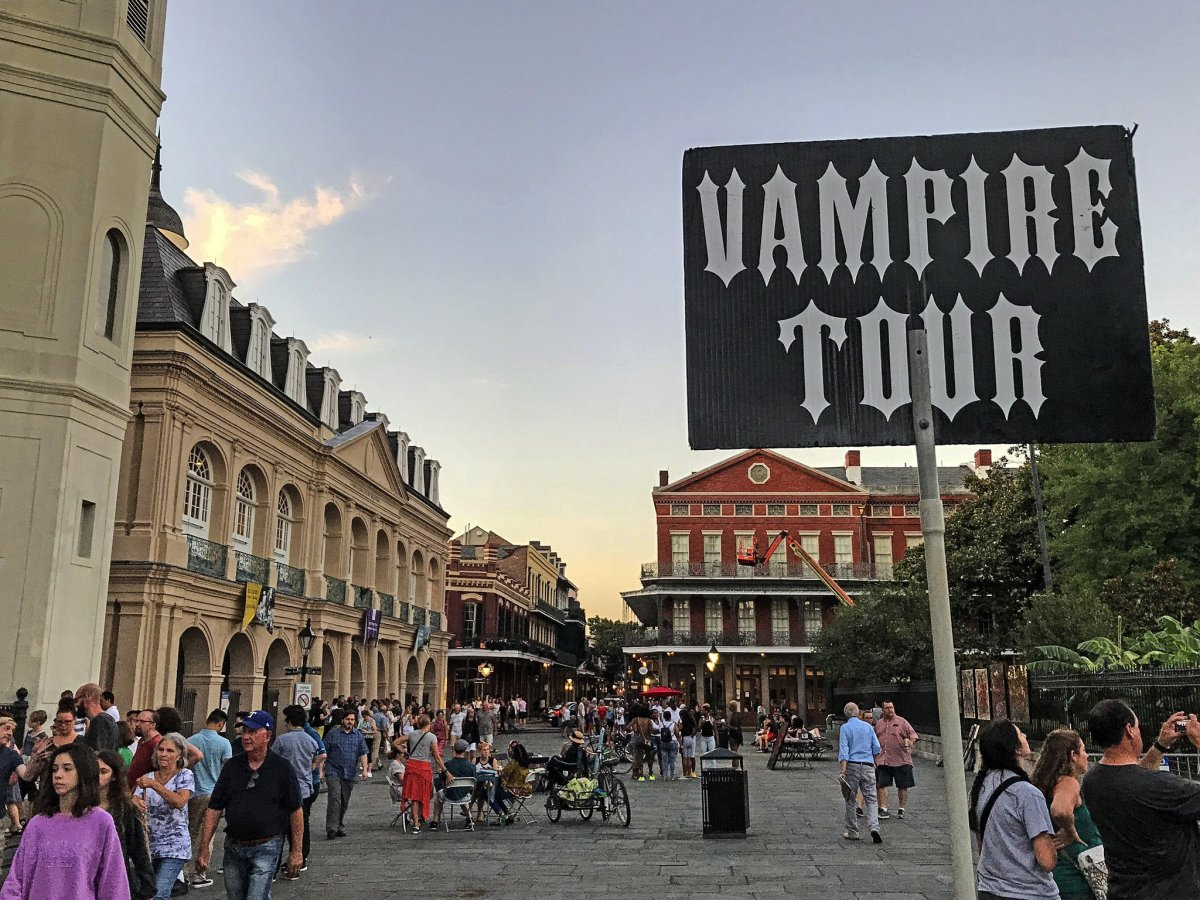 An ominous sign beckons onlookers to take a tour of New Orleans' rich vampire history.