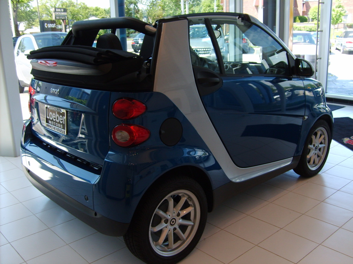 Dealer S Blue Smart Car Side View