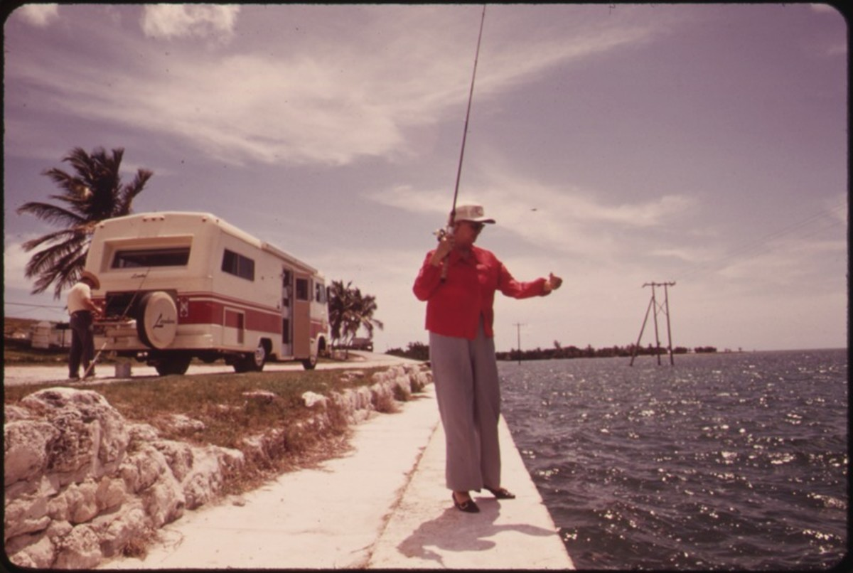 A RETIRED COUPLE FROM CALIFORNIA STOP TO FISH OFF EMBANKMENT AT SPANISH HARBOR KEY. TRAVEL-TRAILERS OF THE KIND OWNED BY THIS COUPLE ARE HIGHLY POPULAR AMONG VISITORS TO THE KEYS