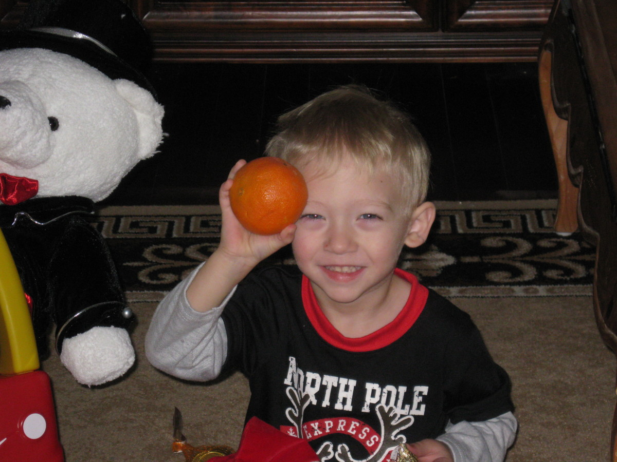 Alex is enjoying his Christmas orange!