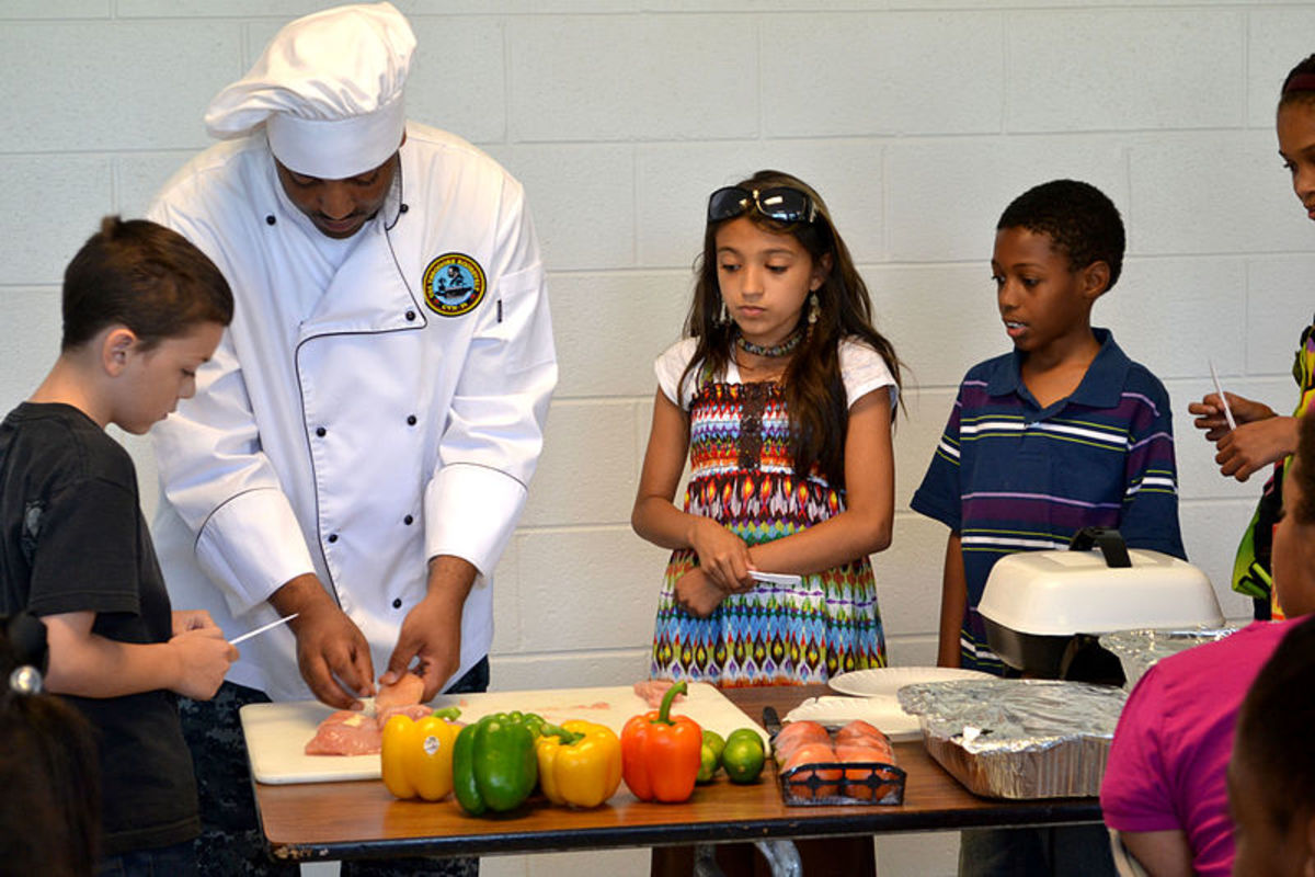 A professional chef giving a cooking lesson