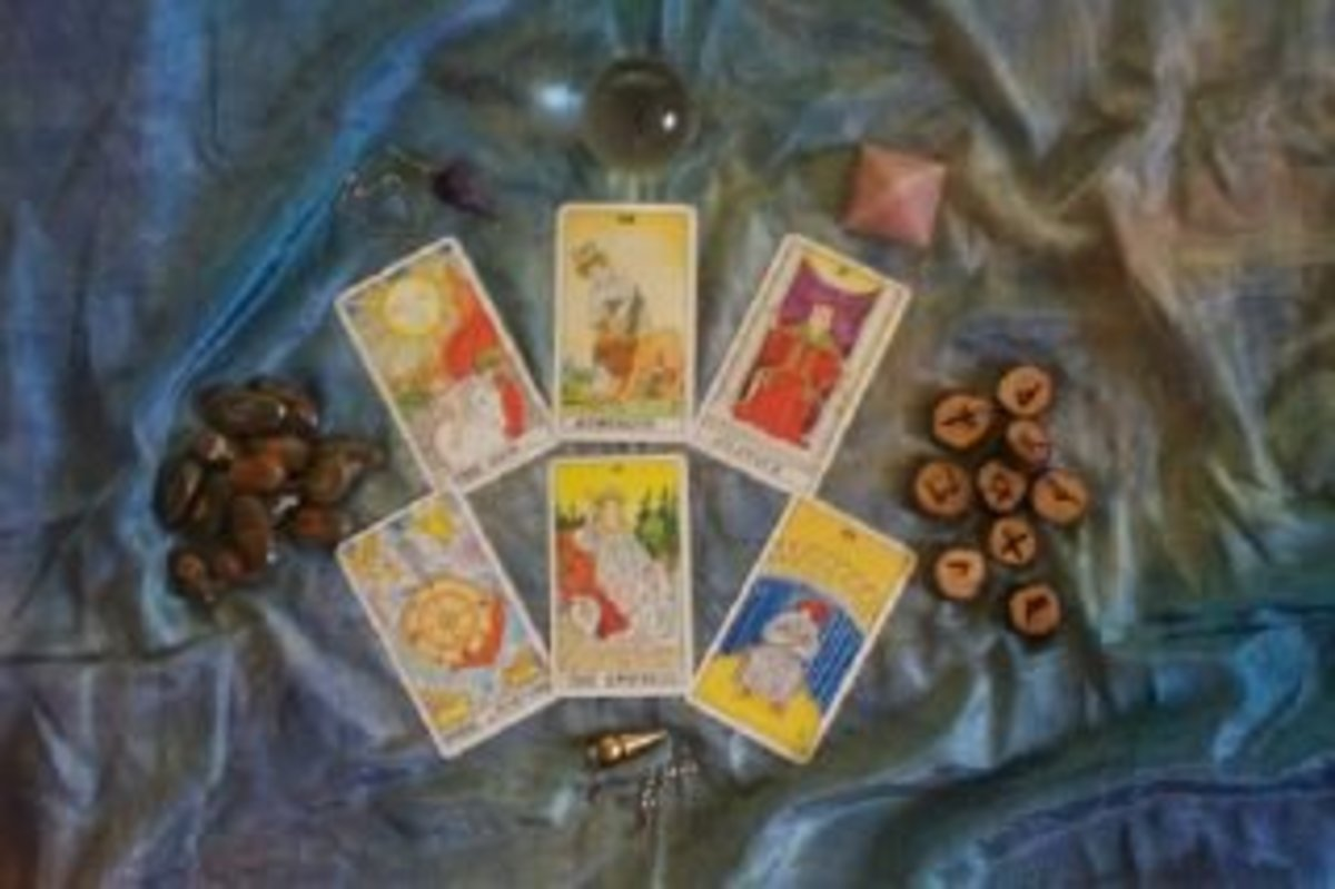 Tarot, runes, crystals and pendulum.