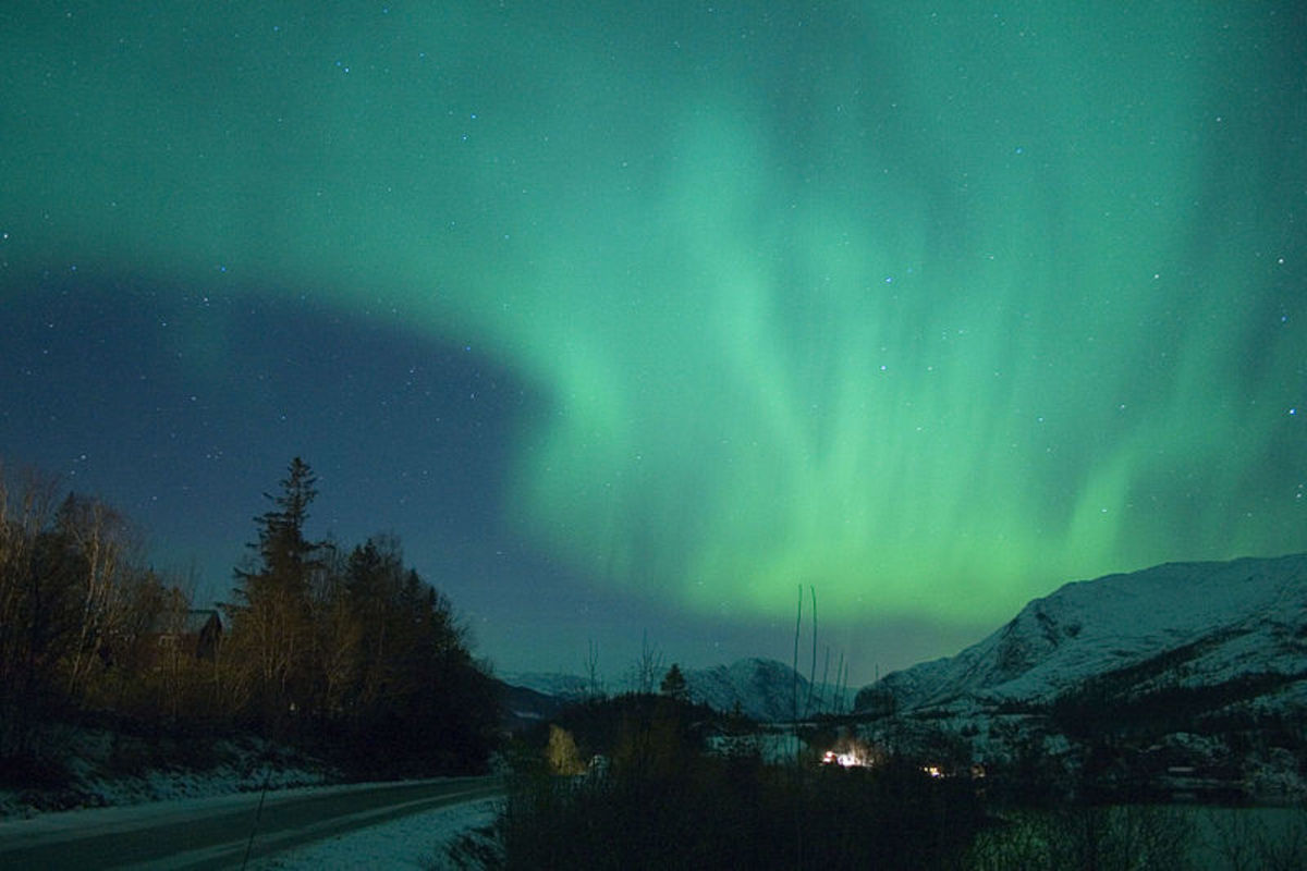 The Northern Lights fill the winter night sky in Norway.
