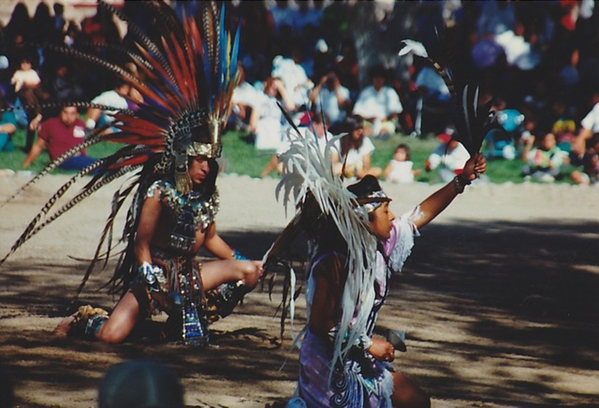 Performing in a pow wow dance competition and demonstration.