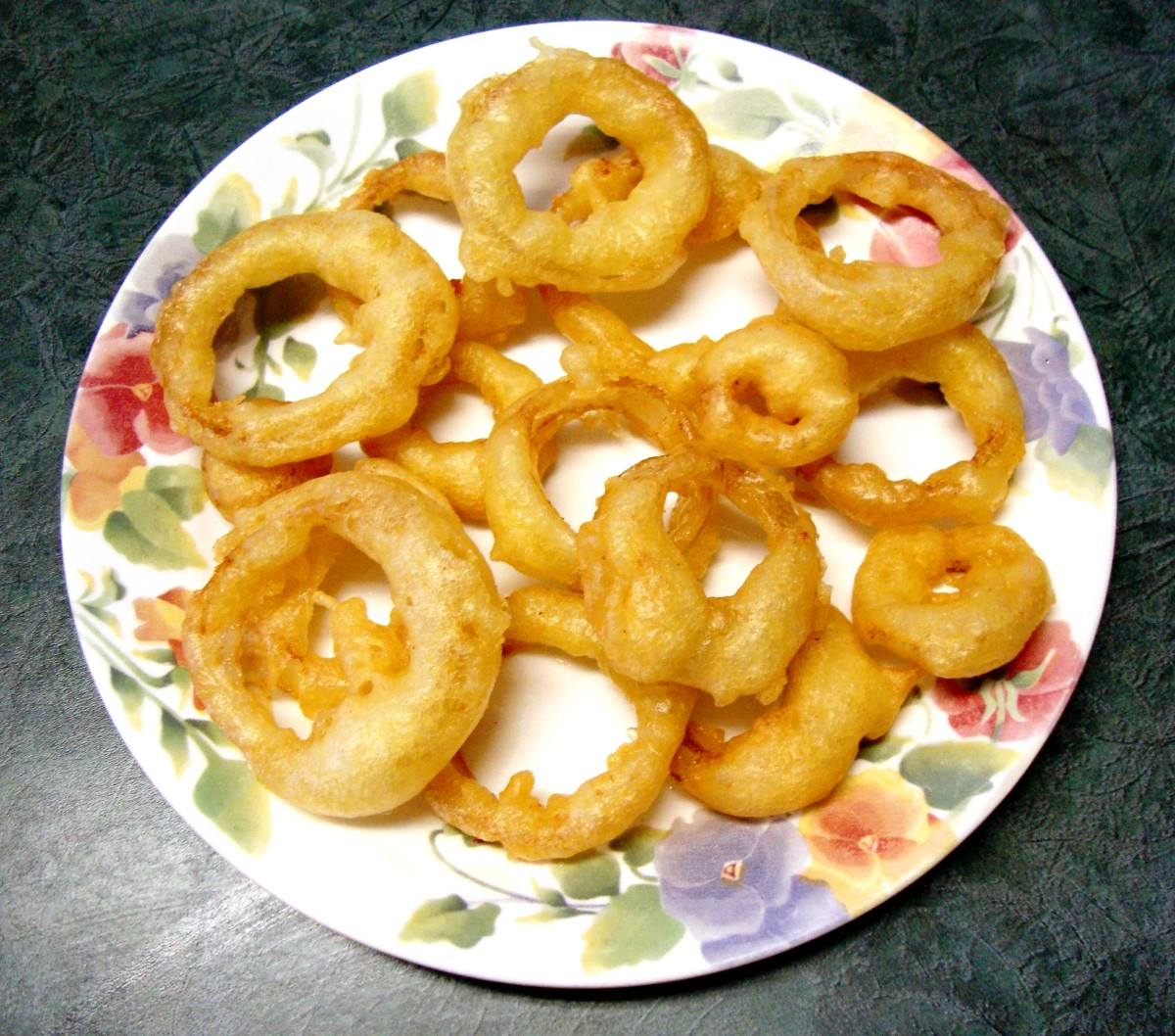 Puffy fried onions rings made in the home kitchen.