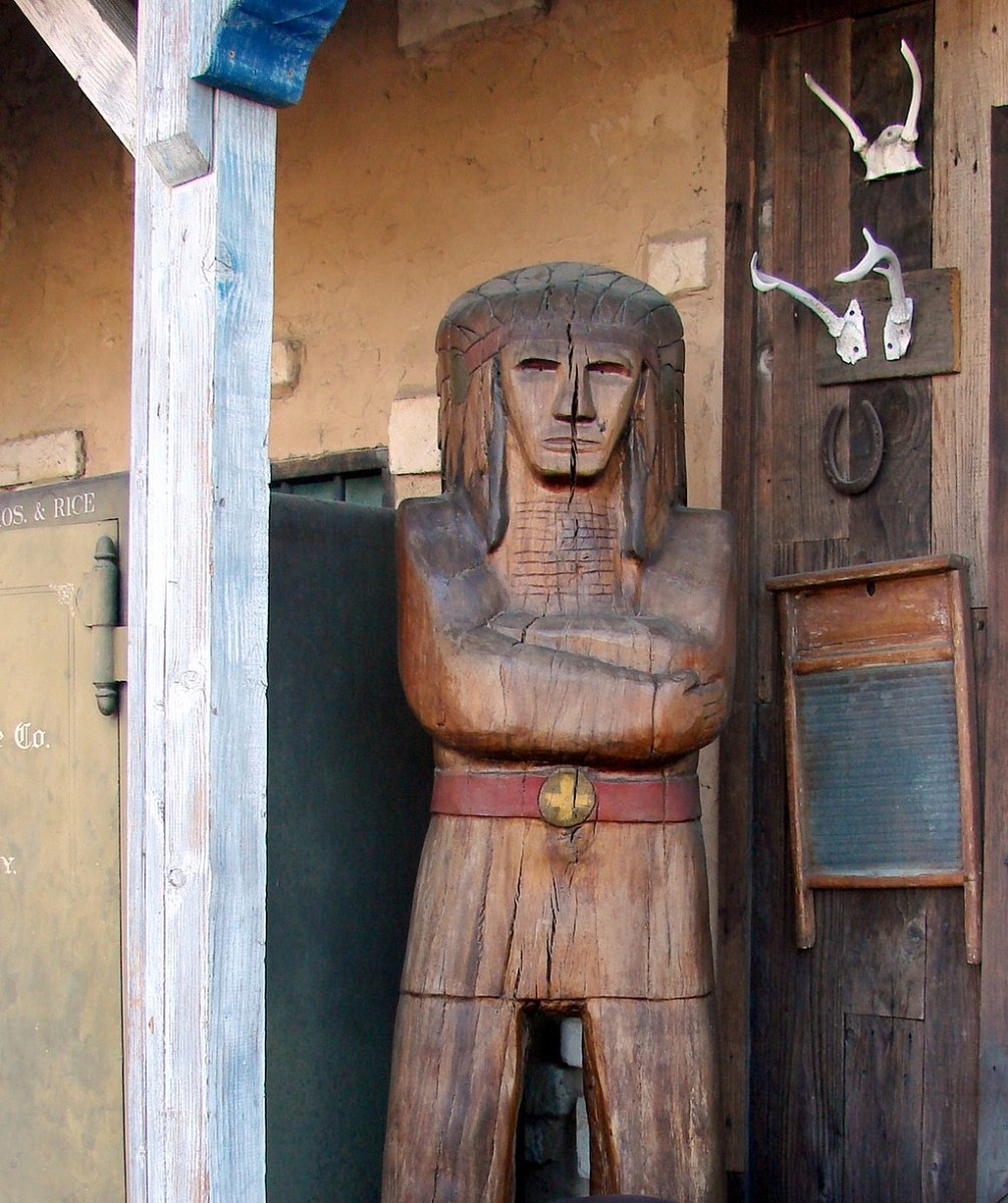 Wooden Indian in front of a tobacco store.