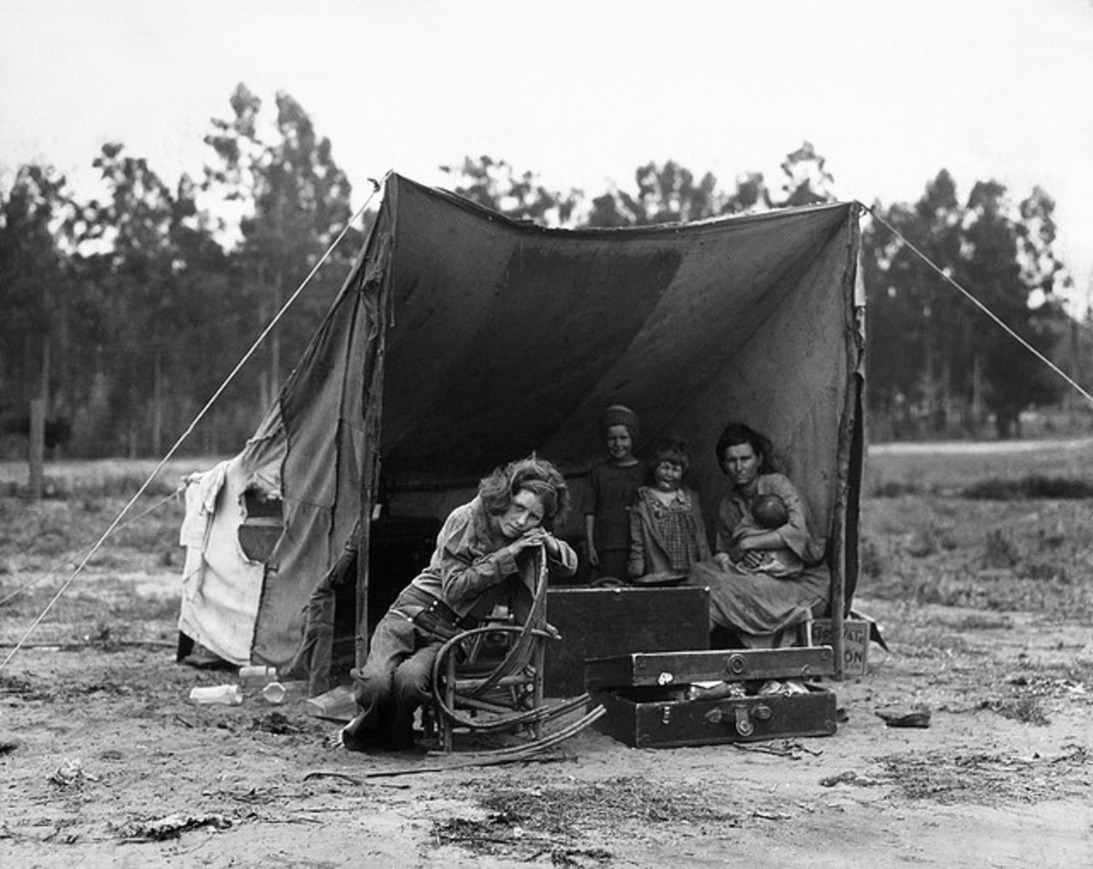 Family in the Great Depression living in a makeshift tent.