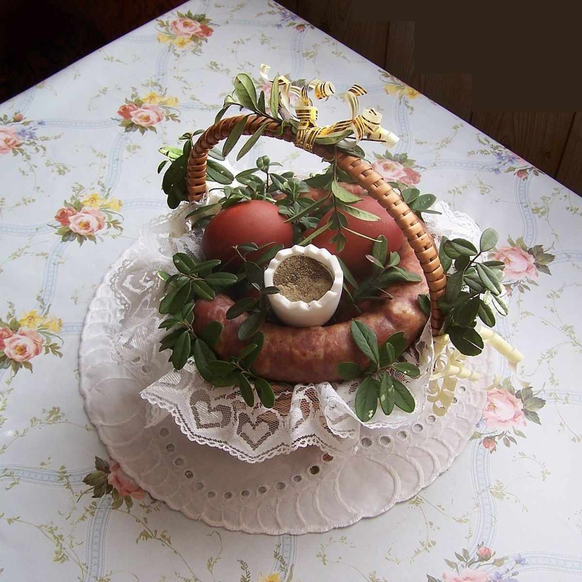 This is one type of Polish Easter Basket that is used to carry food to church for blessing on Easter Saturday. It has kielbasa, boiled eggs, salt, pepper and bread.