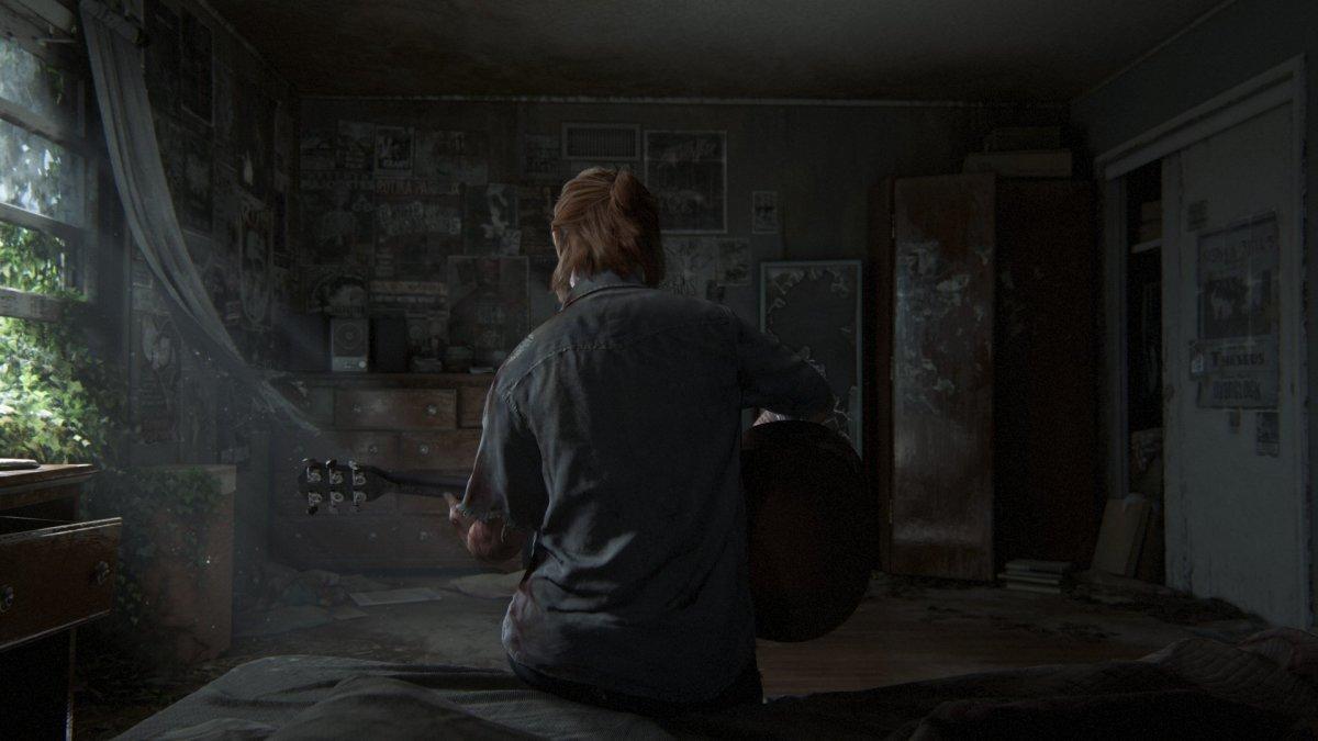 Ellie playing Joel's guitar.