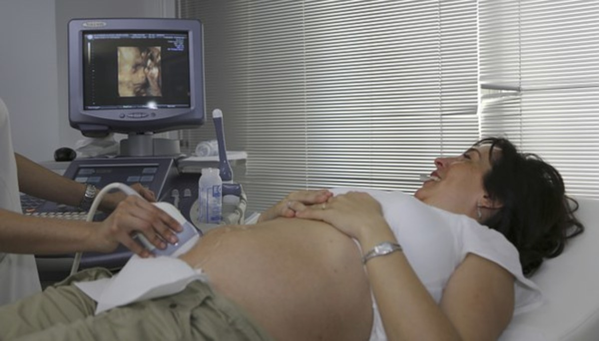 A pregnant woman undergoing an ultrasound scan.
