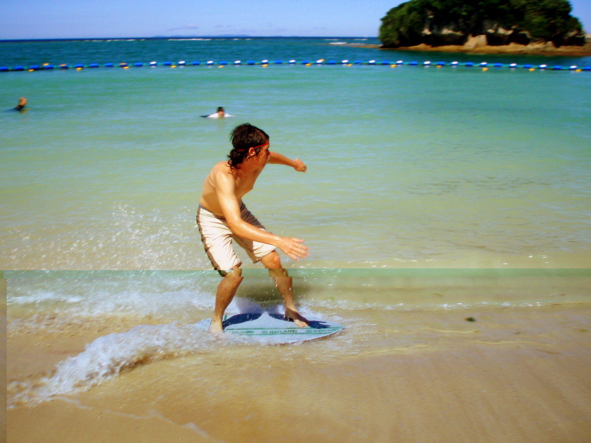 Beach skimboarding in Okinawa, Japan