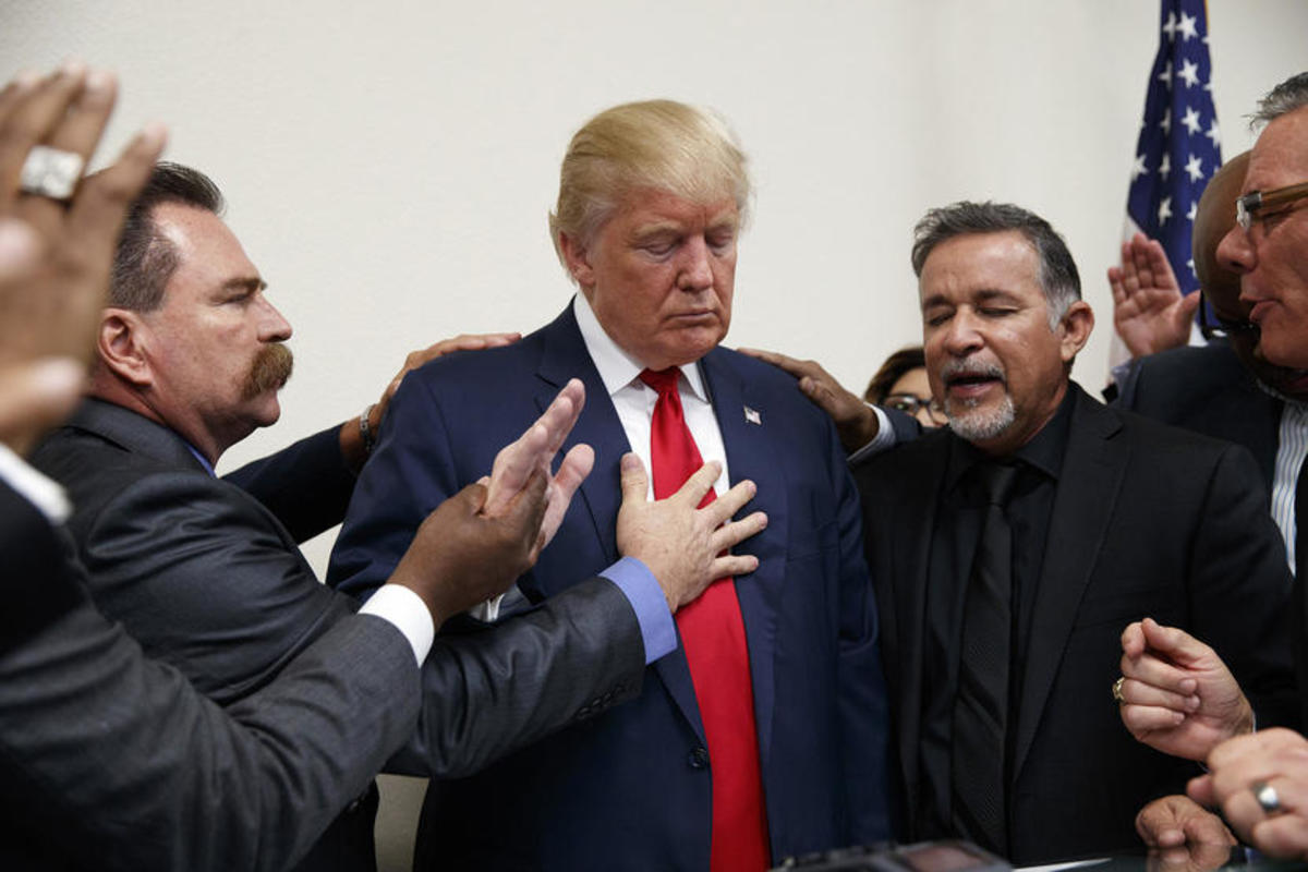 Pastors from the Las Vegas area pray with Republican presidential candidate Donald Trump during a visit to the International Church of Las Vegas, and International Christian Academy on Oct. 5, 2016, in Las Vegas, Nev.