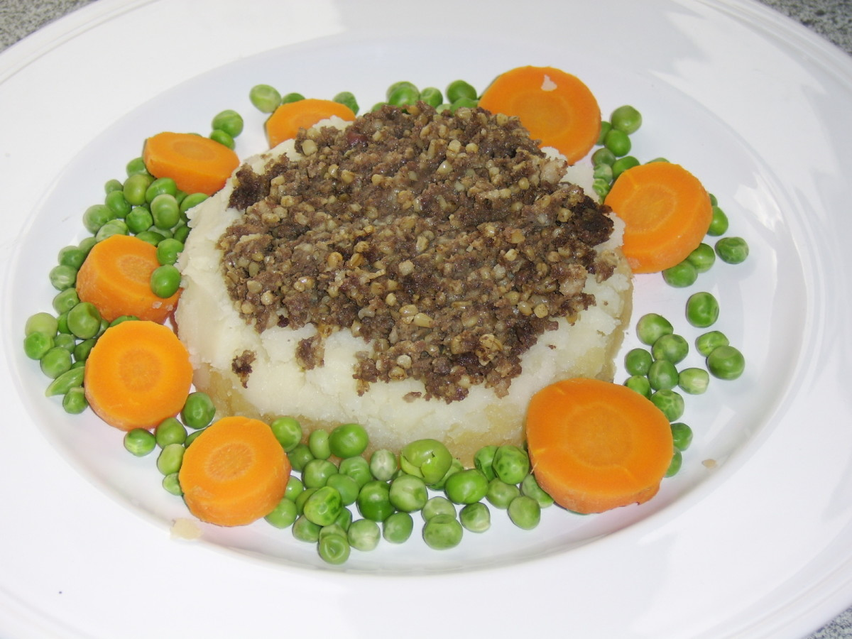 A plate of haggis, tatties and neeps.