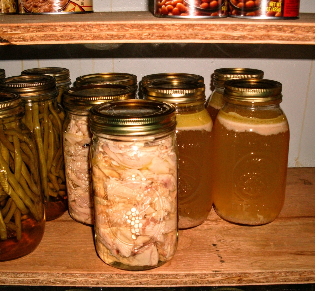Chicken chunks and broth neatly canned, next to green bean pickles. These items look to me like the beginnings of a nice meal. This broth was not skimmed, and it came from a very heavy breed of chicken!