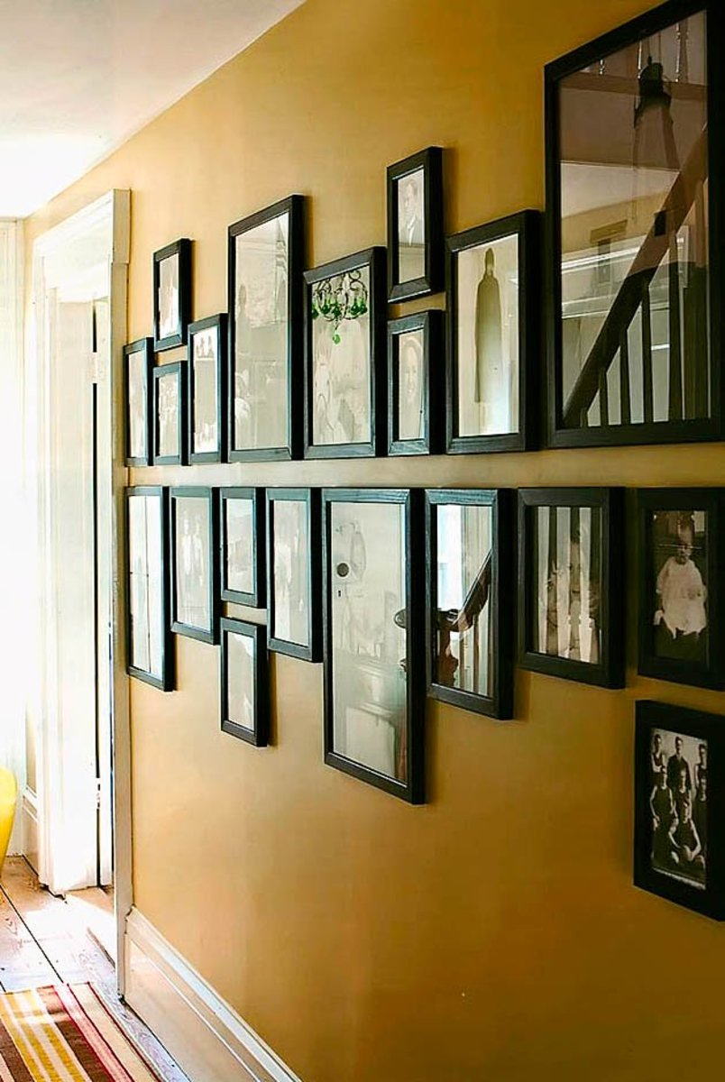 How to display framed photographs on a wall dengarden example of a rectangular photo wall display solutioingenieria Gallery