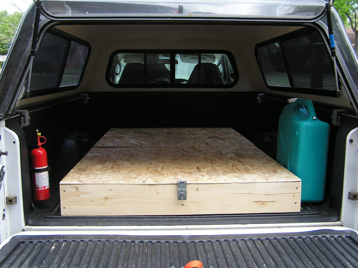 Homemade truck bed storage and sleeping platform for for Tent platform construction