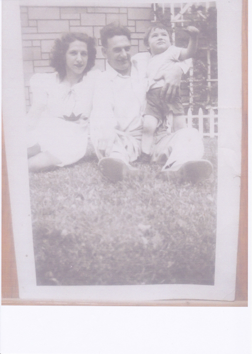 Picture taken in 1945 or 1946; author with mother and father