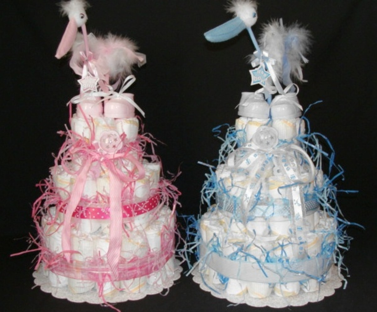Pink and blue diaper cakes.