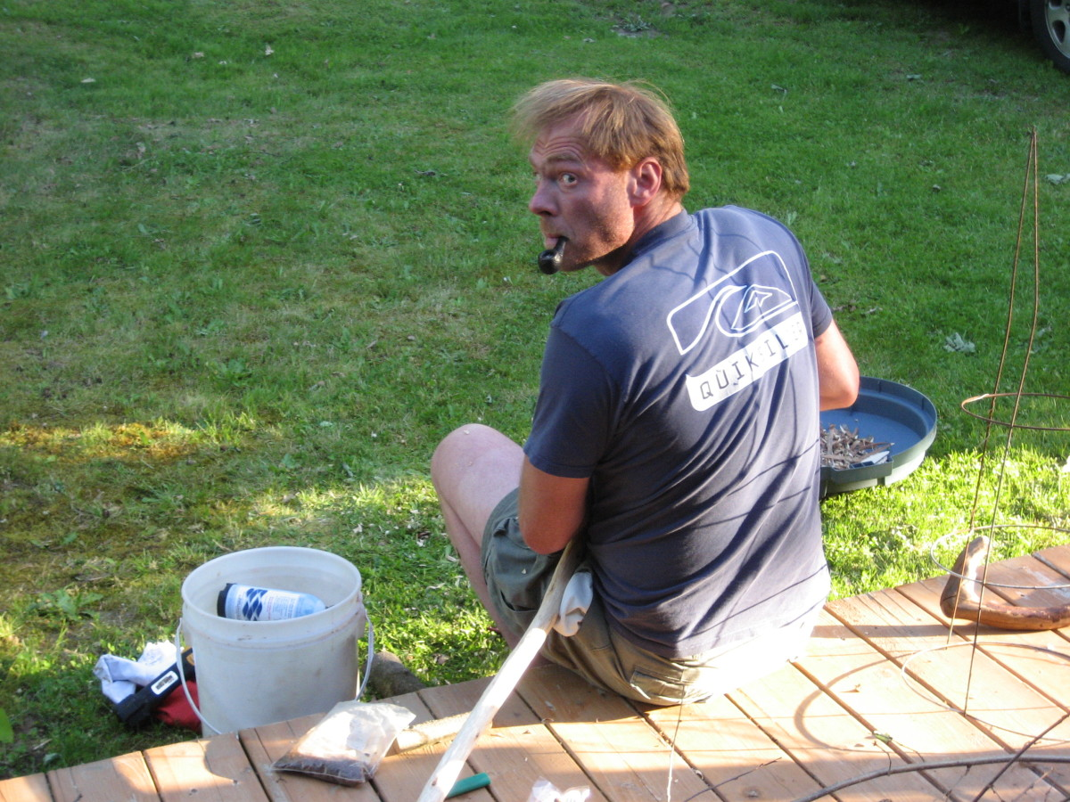 A DIY builder sitting on his work