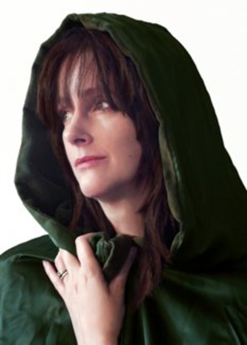The Green Cloak: Fighting crime with her royalty-free and stock image powers.