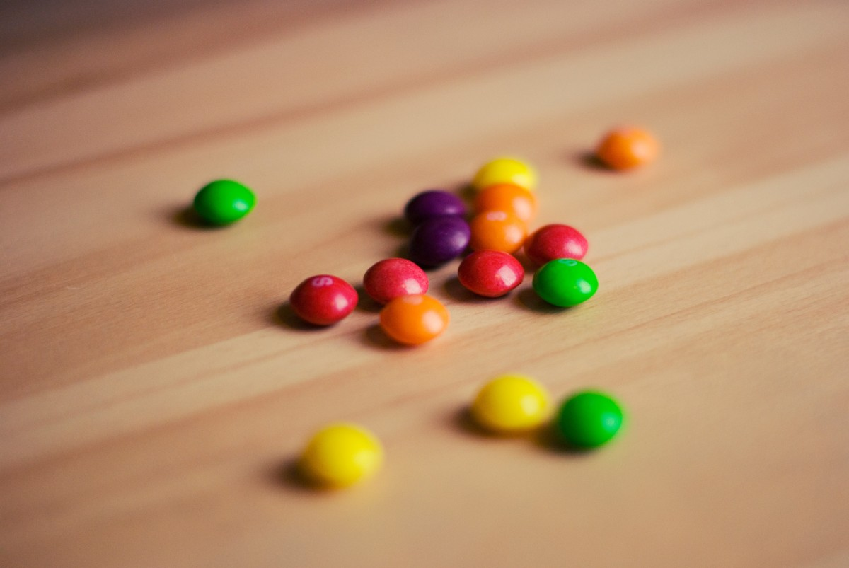 Skittles candies can be used to play an educational and delicious game that teaches about risk versus return.