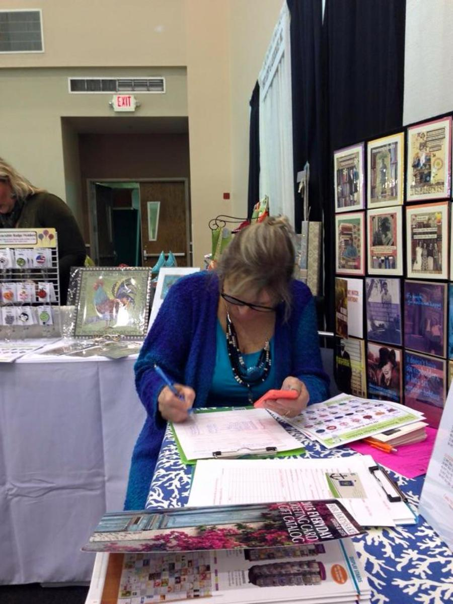 Me, writing orders at the Mid-Atlantic Gift Show
