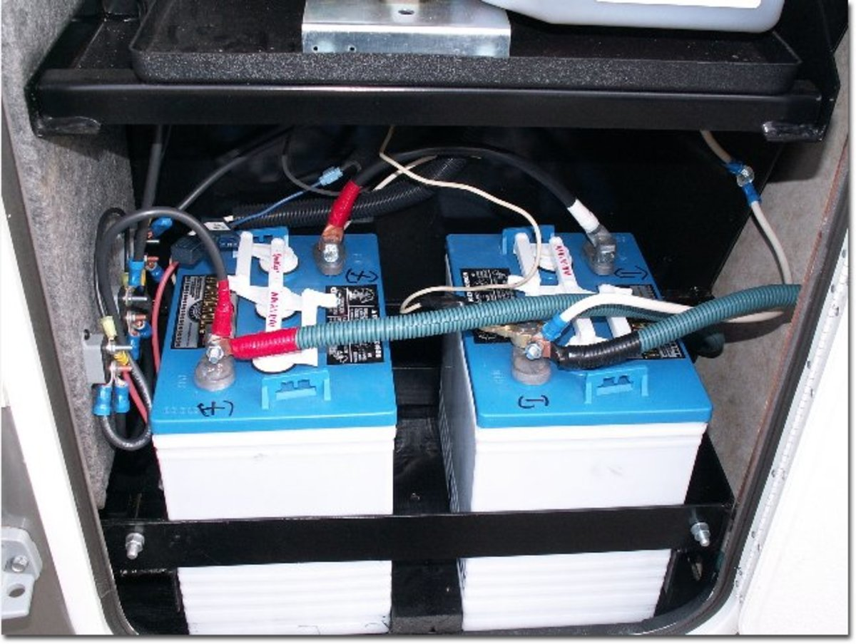 Typical RV COACH batteries: two 6-volt batteries hooked up in series for more current capacity