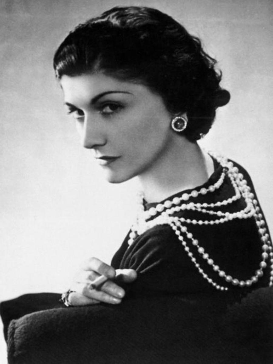 Coco Chanel popularized wearing a little black dress with layered pearl necklaces.