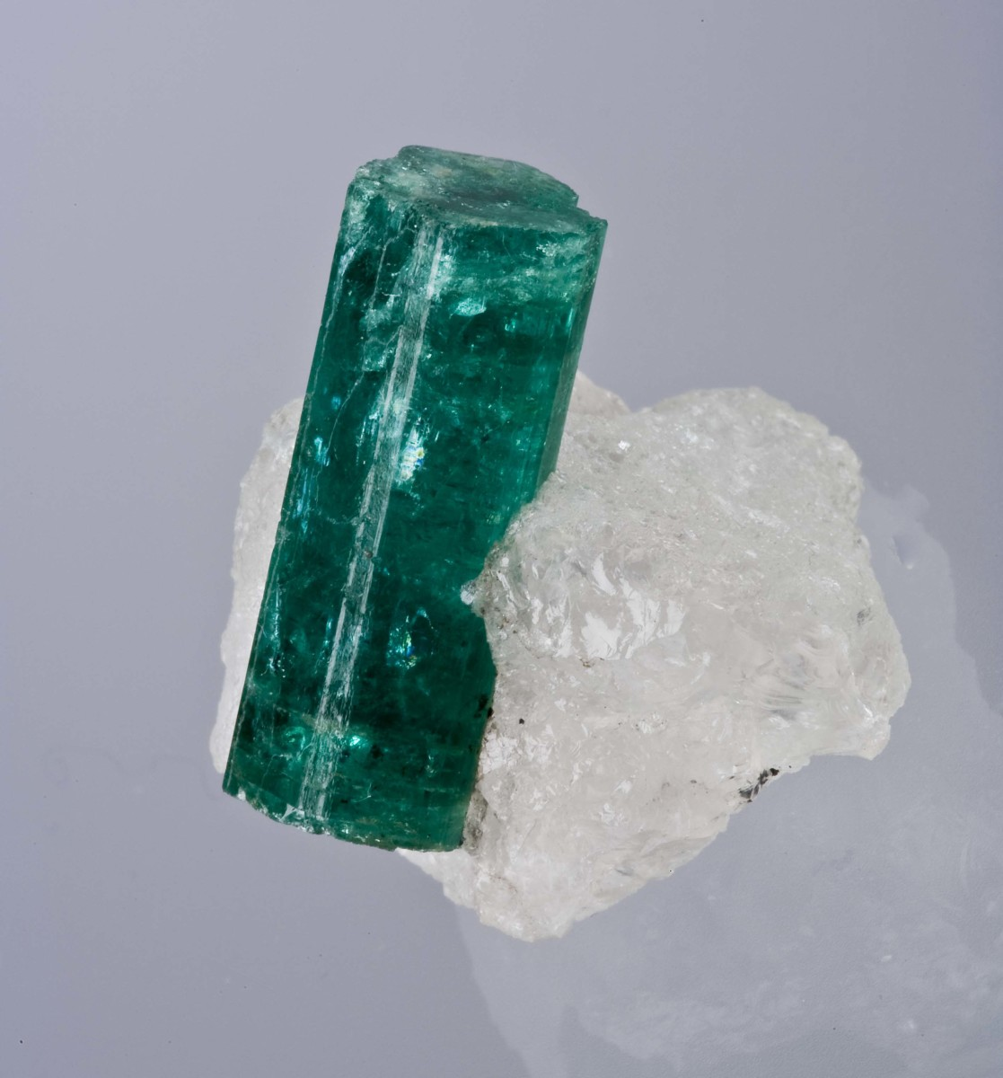 An emerald nestled into a knoll of quartz, as discovered in a Zambian mine.