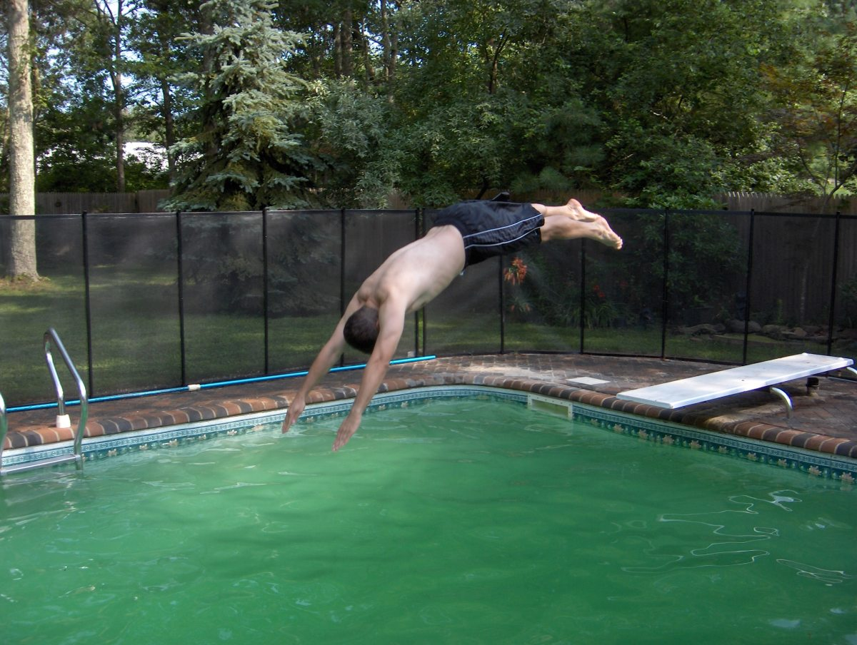 Diving into a green pool.