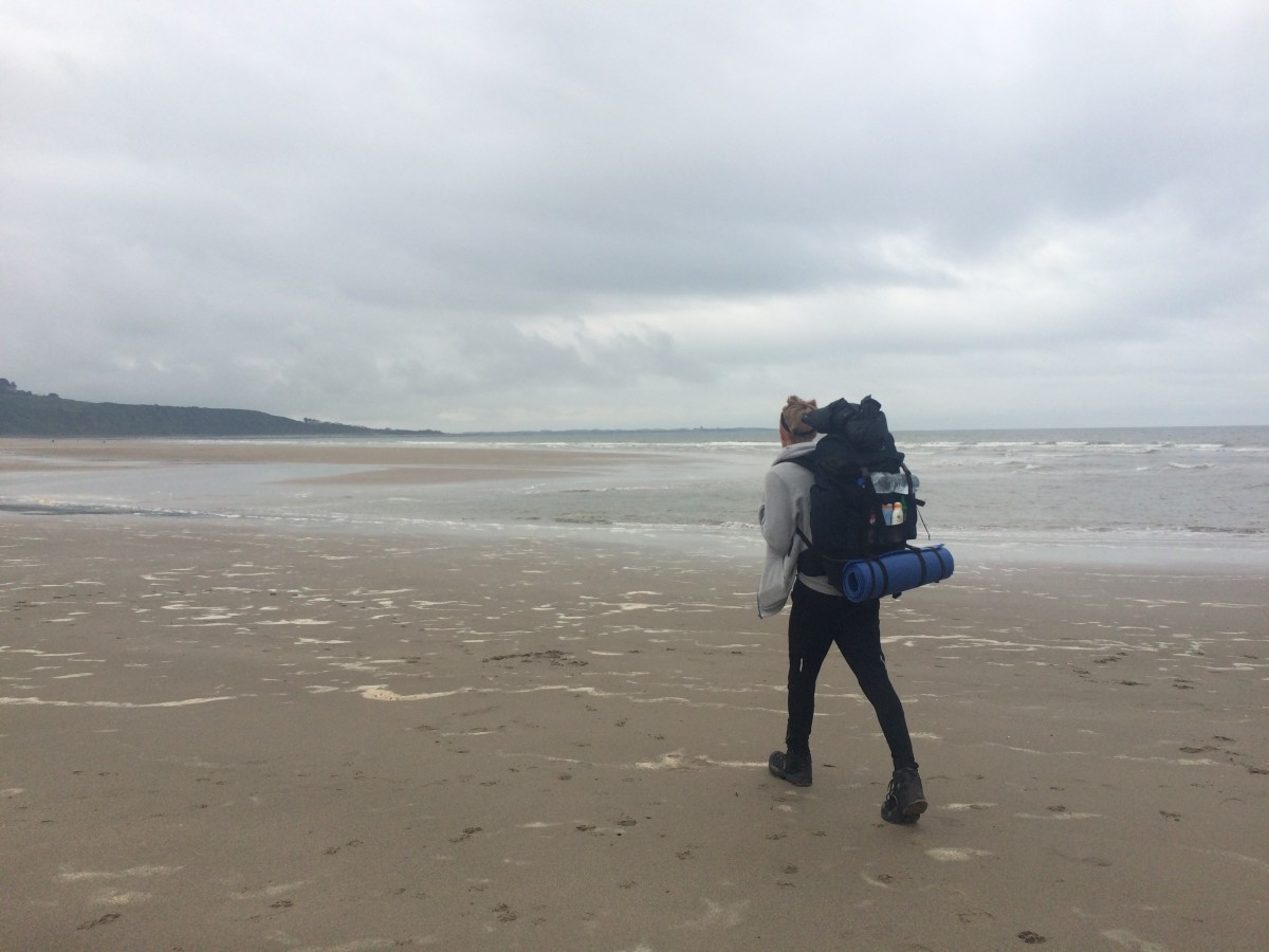 Walking along the soft sands of Harlech Beach