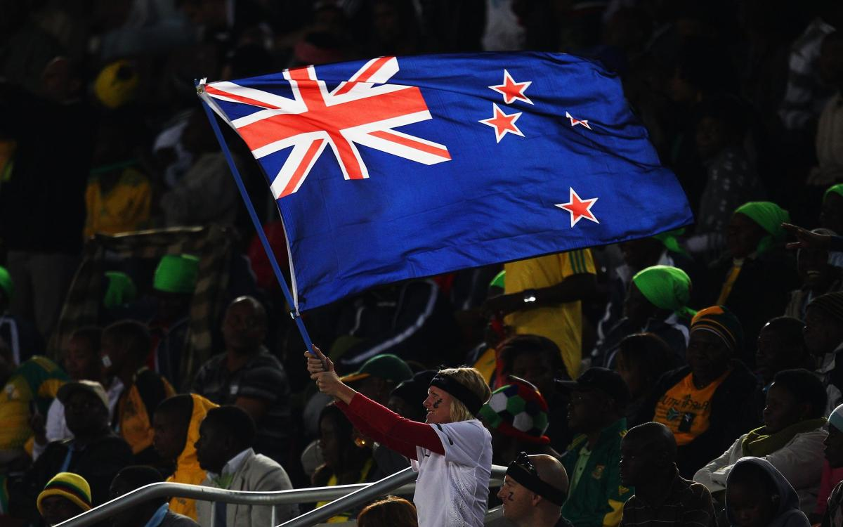 A fan waves New Zealand's flag during a World Cup match against Paraguay in Polokwane, South Africa.