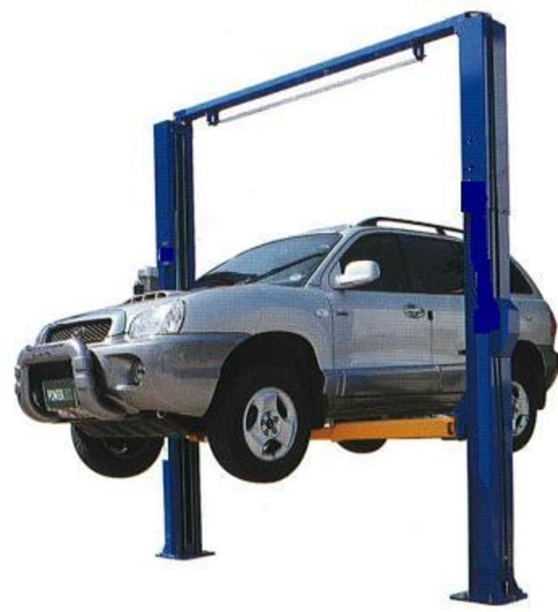 Auto repair shop lift or hoist. This is a 2 post clear span or clear floor hoist.