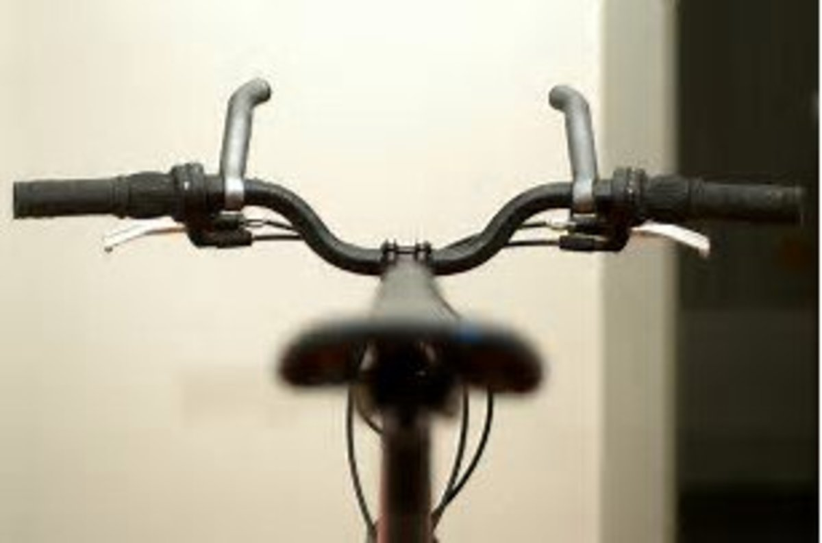 Note how some bar ends fit on the end of the handlebars and some as these shown fit closer to the middle. Bar ends being shown on the handle bars from the riders view.