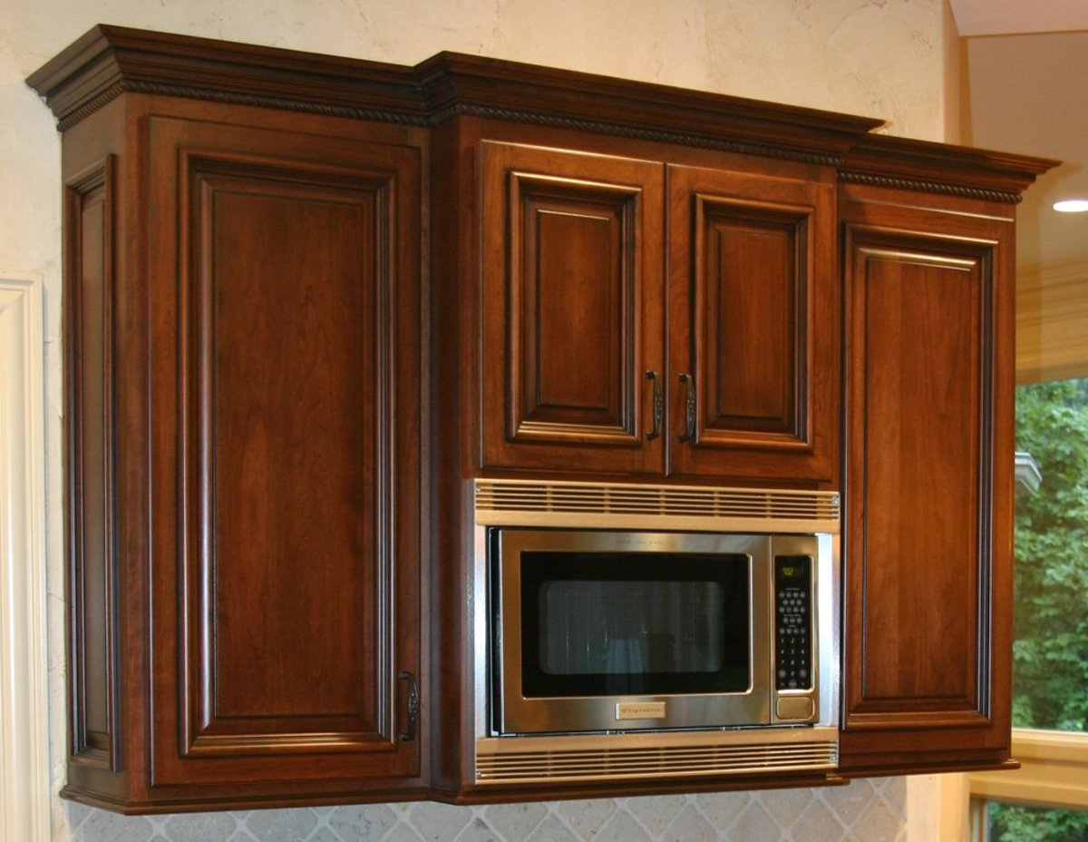 microwave oven with cabinets above and on both sides
