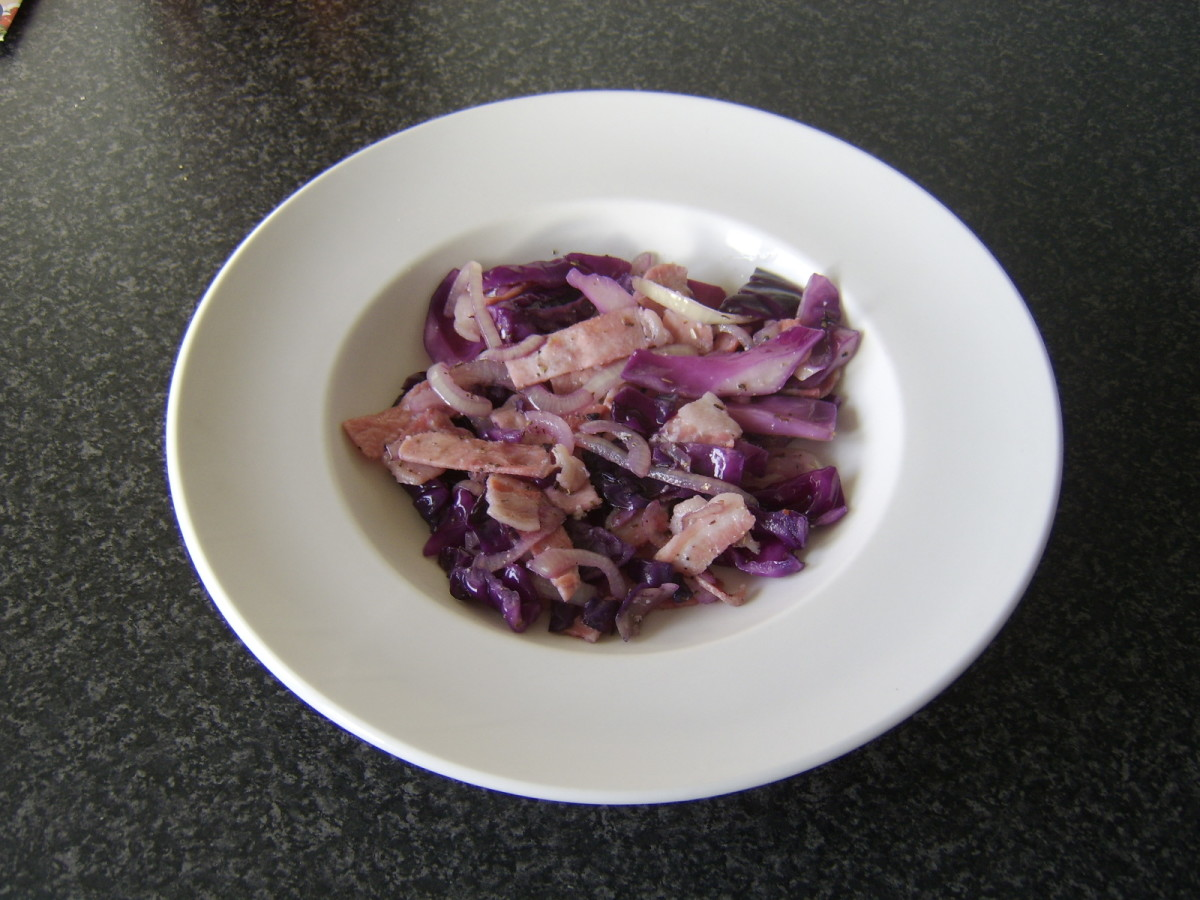 A tasty plate of cooked red cabbage with onion and bacon.
