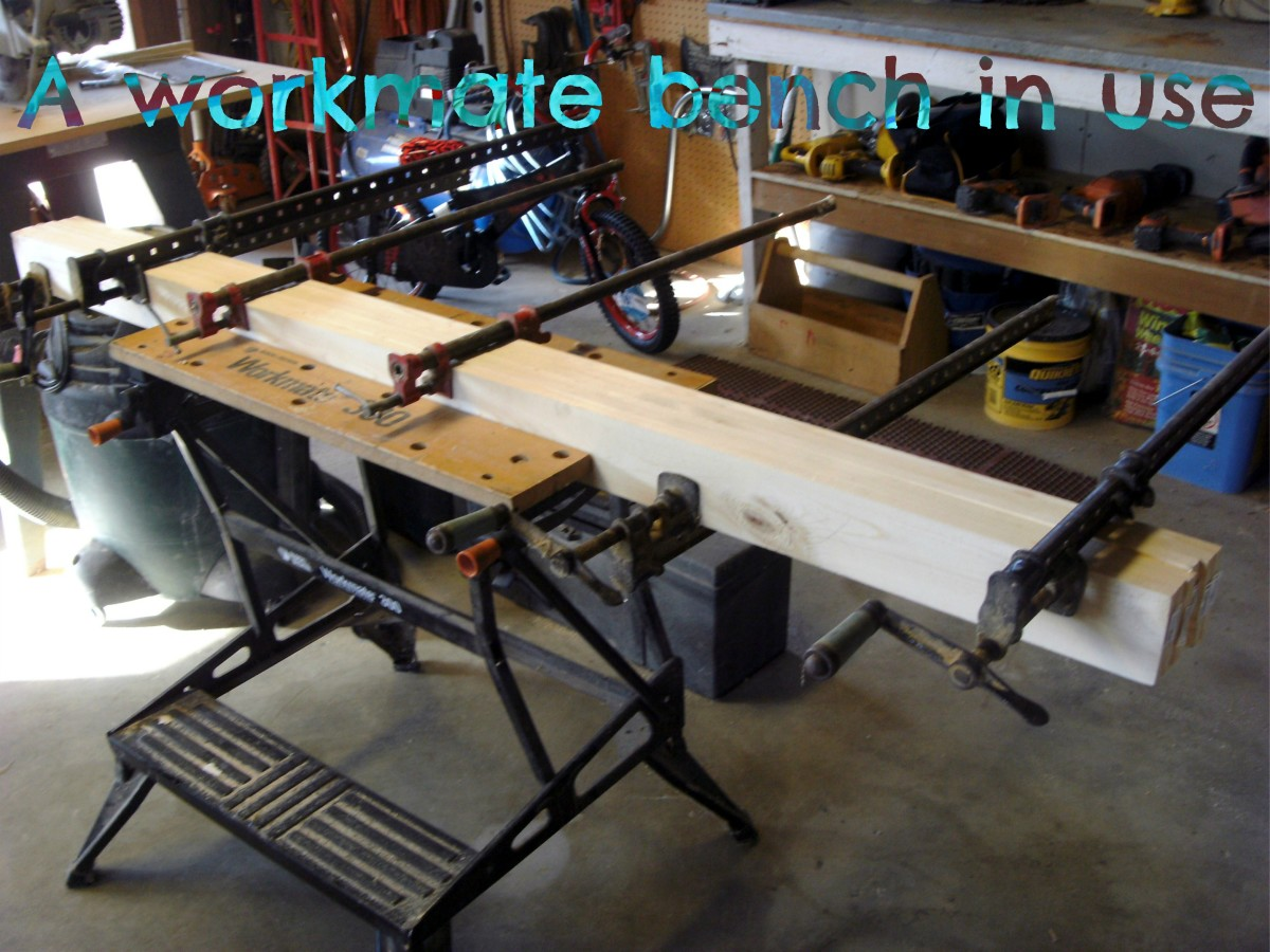 A workmate bench being used to hold a long beam as multiple large clamps were placed.  Much better than the floor!