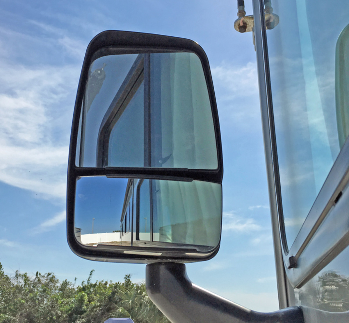 Standard motorhome mirrors are mounted at the front of the RV and are designed to give a both distant and close-up view of the road behind the RV.