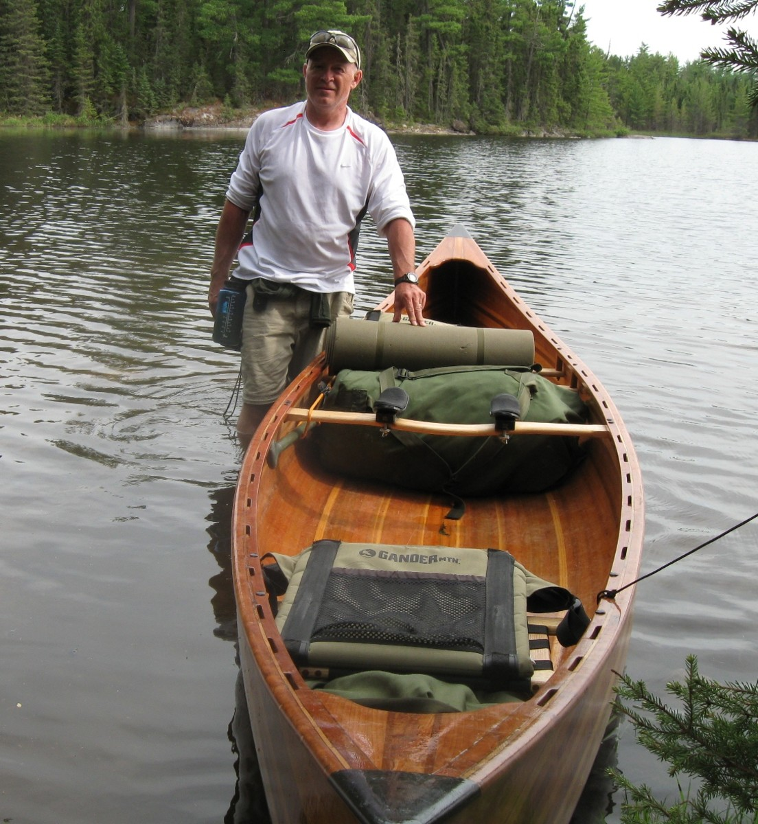 Cedar-strip canoe at a portage