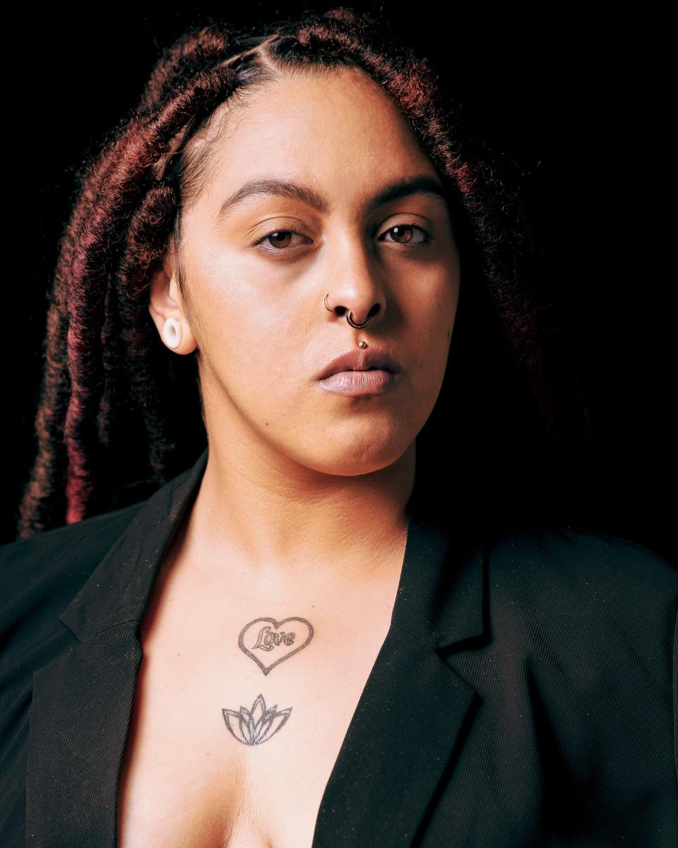 Image of a woman with a medusa piercing