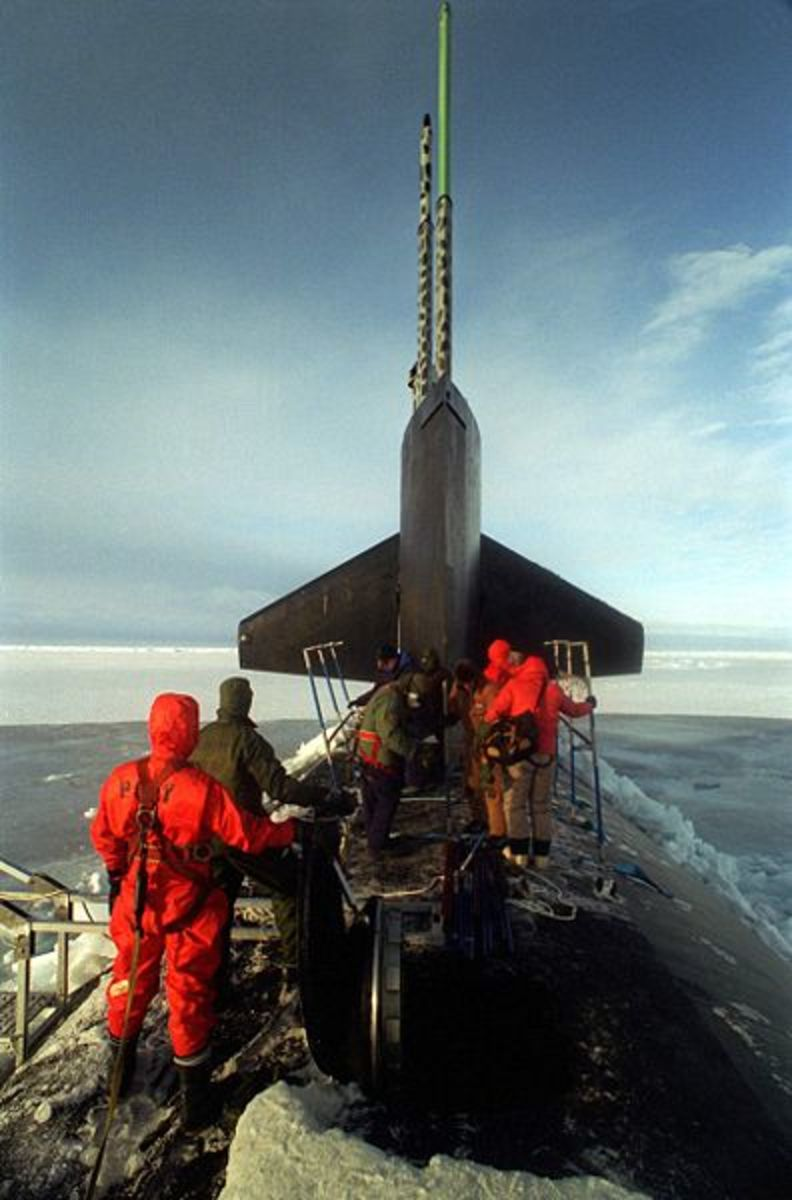 Researchers aboard USS Pogy (SSN-647) taking water samples, 2009.  Image in public domain, but we appreciate the anonymous photographer!